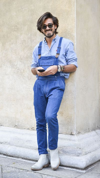 <p>We're not sure what we most admire, this guy's nonchalance (see: denim dungarees), or the wave in his hair flip. </p>