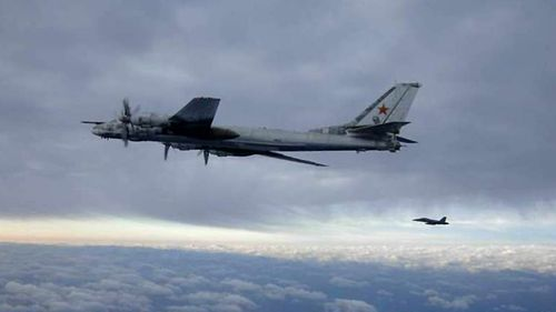 An F/A-18 Hornet strike fighter intercepts one of two Russian Tu-95 Bear long rang bomber aircraft as it approached the US Navy aircraft carrier USS Nimitz in 2008.