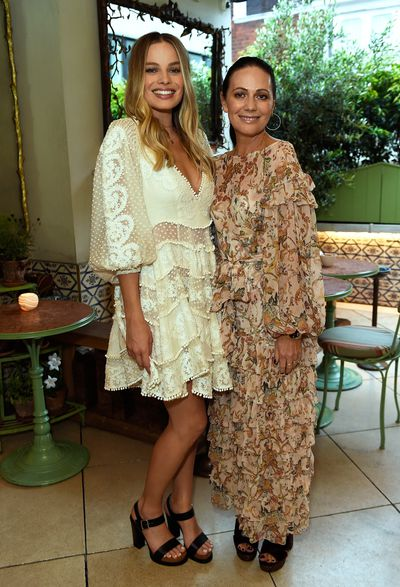 Margot Robbie and Nicky Zimmermann in Zimmermann, celebrating the launch of Zimmermann's London flagship store in Mayfair at the private members' club 5 Hertford St, London.