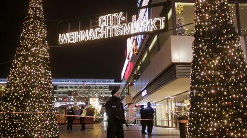 Police are guarding the scene at the Berlin Christmas market. (AAP)