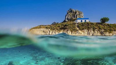 """Summer in Greece: """"The small island that you see in the picture is named Kastri and it's located near Kefalos Village in the beautiful island of Dodecanese Kos. The shot was taken with the use of an underwater camera housing."""" Georgios Papapostolou, winner, Greece, National Award, 2015 Sony World Photography Awards."""