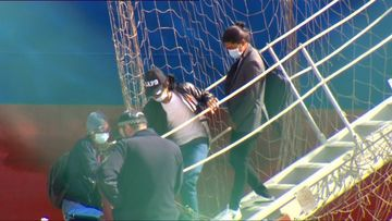 Workers disembarking the ship today.