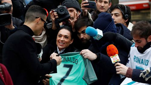 Ronaldo signed autographs for fans as he left court.