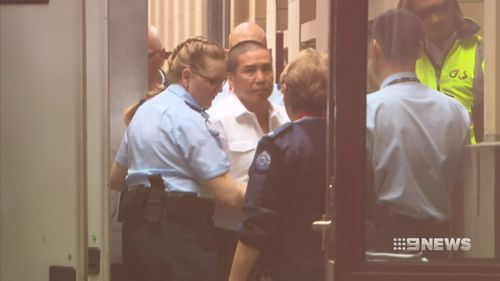 Hung Ang Vu, centre, has pleaded not guilty to murder and attempted murder.