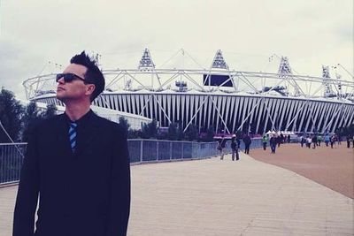 Blink-182's Mark Hoppus poses in front of Olympic Stadium.