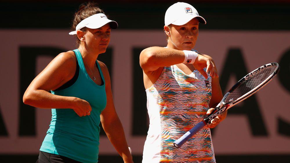 Rain halts Aussies at Wimbledon