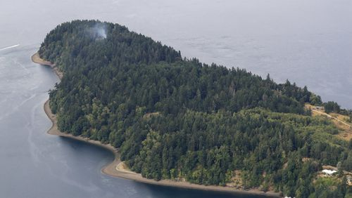 Smoke rises from the site on Ketron Island.