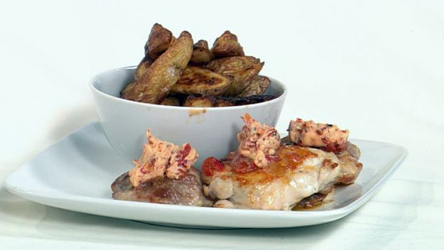 Pan-fried chicken with chilli butter and potato wedges with lemon pepper