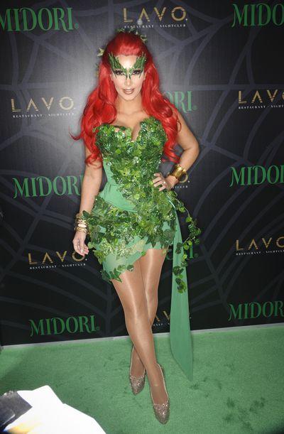 Kim Kardashian dressed as Poison Ivy at the 2011Midori Green Halloween costume party.