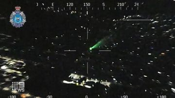 Man charged after laser pointed at police helicopter