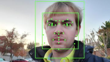 Artificial Intelligence system from Google Vision, performing Facial Recognition and emotion analysis on a photograph of a man.