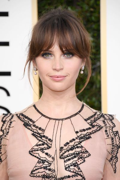 <p>Her gown didn't win our hearts - but Felicity Young's hair and makeup certainly did. Those loose wispy strands gave her look just the right touch of whimsy and her makeup was perfectly pretty.</p> <p>Image: Getty.</p>