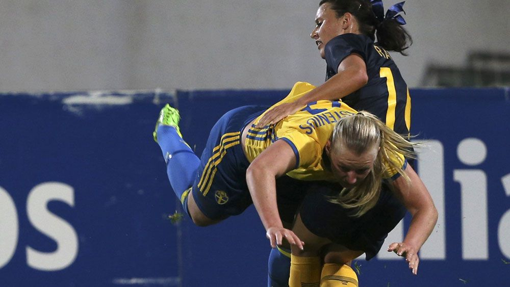 Australia's Hayley Raso and Sweden's Stina Blackstenius pulled no punches in the Algarve Cup. (AAP)