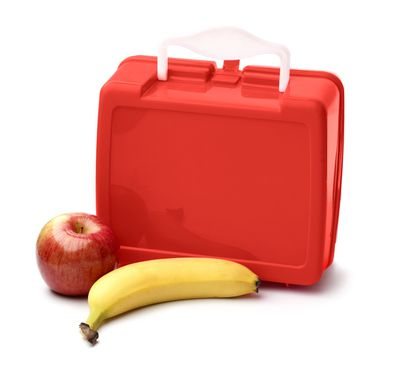 School lunch apple and banana next to red lunch box