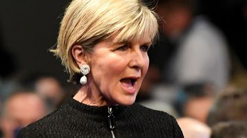 Minister for Foreign Affairs Julie Bishop attends the North Melbourne football club grand final breakfast. (AAP)