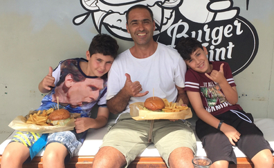 Yoav with his boys eating burgers