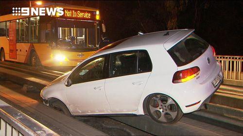 The Volkswagon Golf became wedged in the tracks under the Darley Road bridge just after 4am.