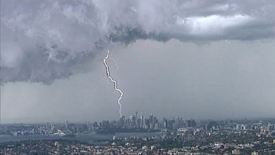 Lightning is seen above Sydney CBD. (9NEWS)