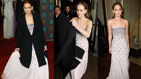 Jennifer Lawrence's dress drenched on rainy BAFTAs red carpet