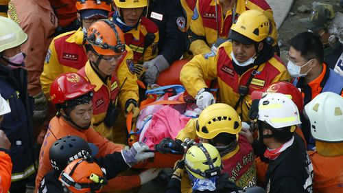 Survivors pulled out from Taiwan building two days after quake