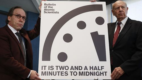 Lawrence Krauss, left, and Thomas Pickering, co-chair of the International Crisis Group, display the Doomsday Clock. (AAP)