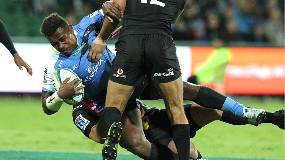 Junior Rasolea is stopped by the Bulls defence. (AAP)
