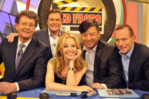 Kylie Minogue (centre) with Red Symons, host Daryl Somers, Entourage actor Rex Lee and former prime minister Tony Abbott. (AAP)