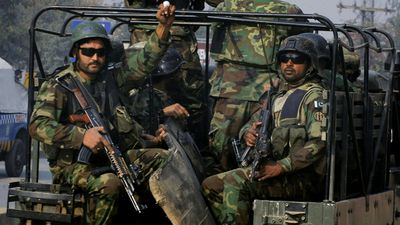 Pakistani military troops arrive at the school. (AAP) <br> <br> The Tehreek-e-Taliban Pakistan claimed responsibility for the assault, calling it revenge for a major military offensive in the region.