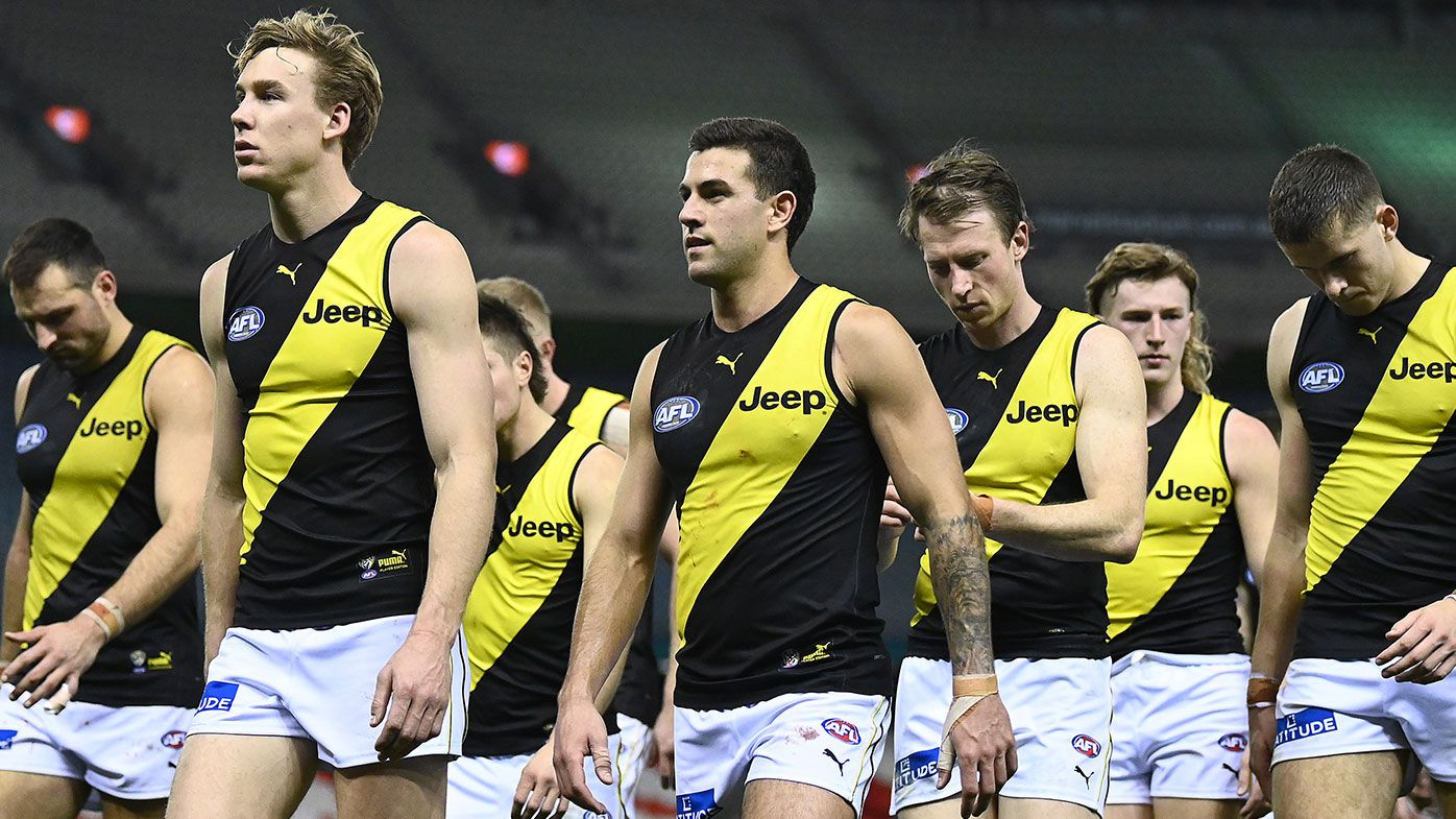 The Tigers look dejected after losing the round 22 AFL match between Greater Western Sydney Giants and Richmond Tigers at Marvel Stadium on August 13, 2021 in Melbourne, Australia. (Photo by Quinn Rooney/Getty Images)