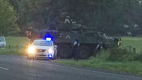 NZ siege over as gunman gives himself up