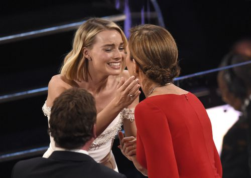 Margot Robbie, left, congratulates Allison Janney, winner of the award for best performance by an actress in a supporting role for I, Tonya. (AAP)