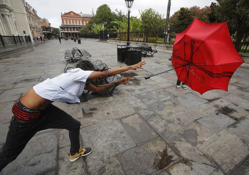 A man in the French Quarter plays with his umbrella in the wind of Tropical Storm Barry in New Orleans, Louisiana, USA.