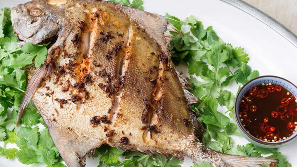 Deep-fried whole black pomfret with lime and chilli dressing