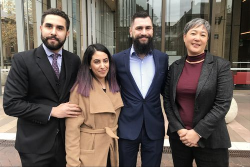 Plaintiffs Tom Raue (second right) and Elizabeth Mansour (second left) with lawyer Jahan Kalantar (left) and NSW Greens MP Jenny Leong (right) at the Supreme Court in Sydney, Friday, June 8, 2018. The plaintiffs are planning to file an injunction in the Supreme Court to stop a weekend NSW Police drug sniffer dog plan. (AAP)