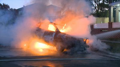 Crews work to contain fire after car bursts into flames in Sydney's west
