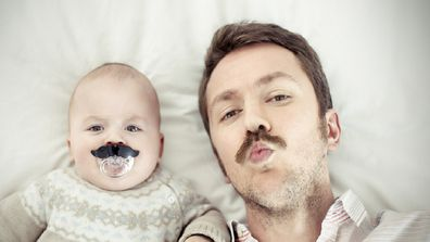 Portrait of a father with his son, both with mustaches