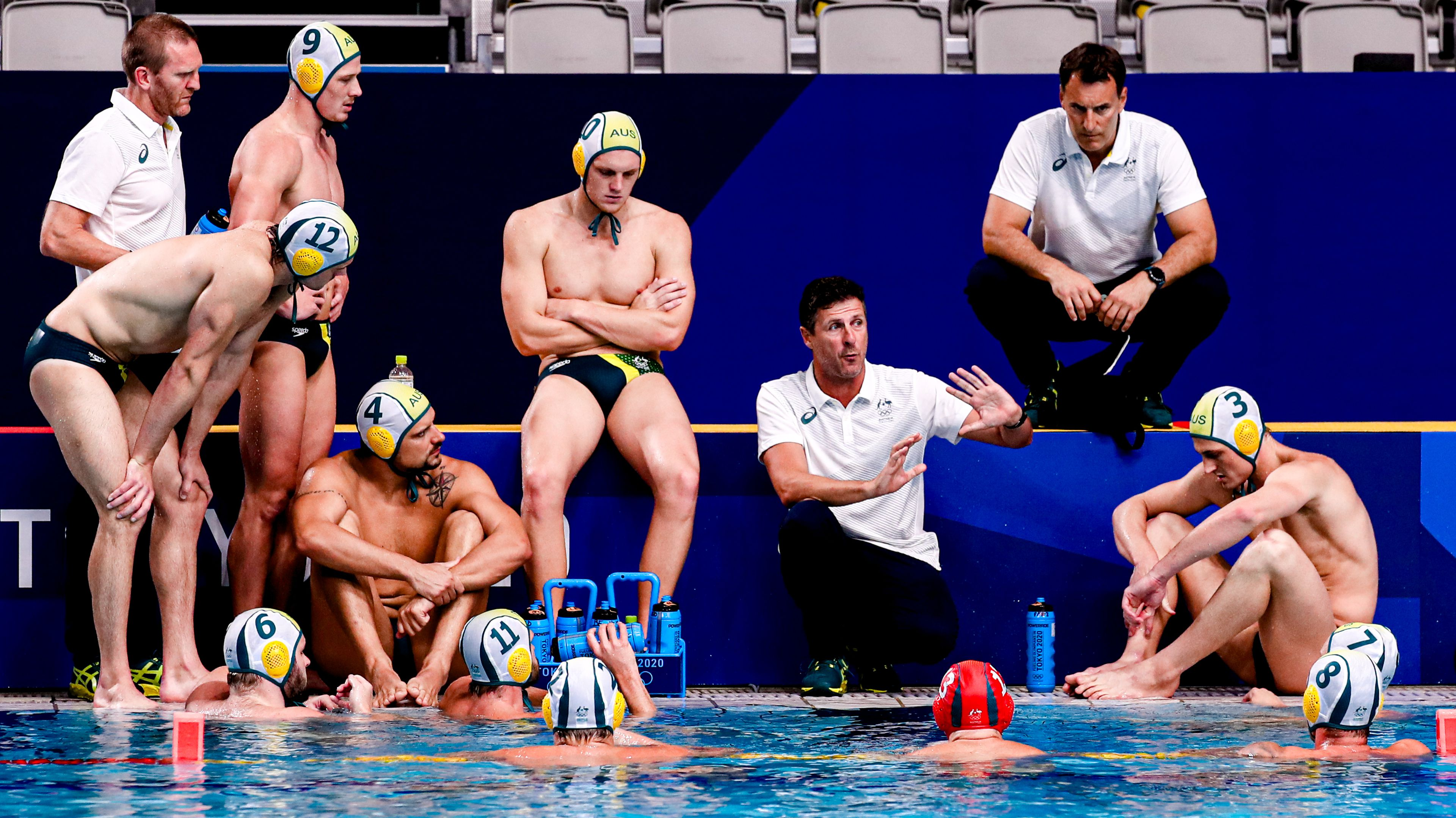 Australia's coach Elvis Fatovic addresses his players in Tokyo.