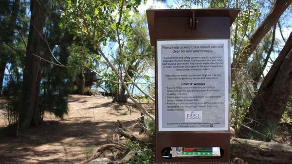 Sign post with waste bags for poo on Florida's Indian River Lagoon