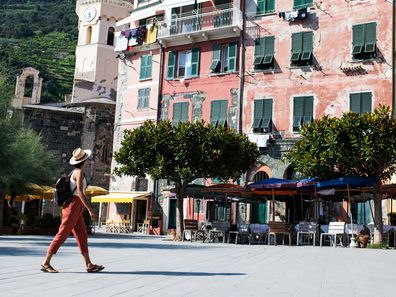Woman walking in Cinque Terra