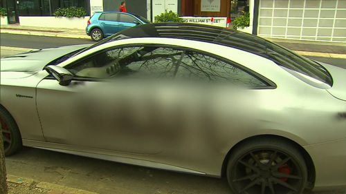 What the woman spray painted can't be shown for legal reasons. Image: 9News