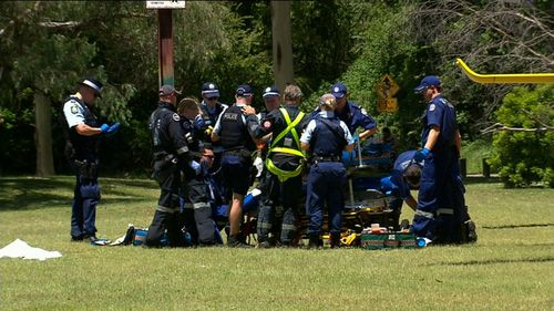 Paramedics attended to the man who was pulled unconscious from the Colo River, but he could not be saved.