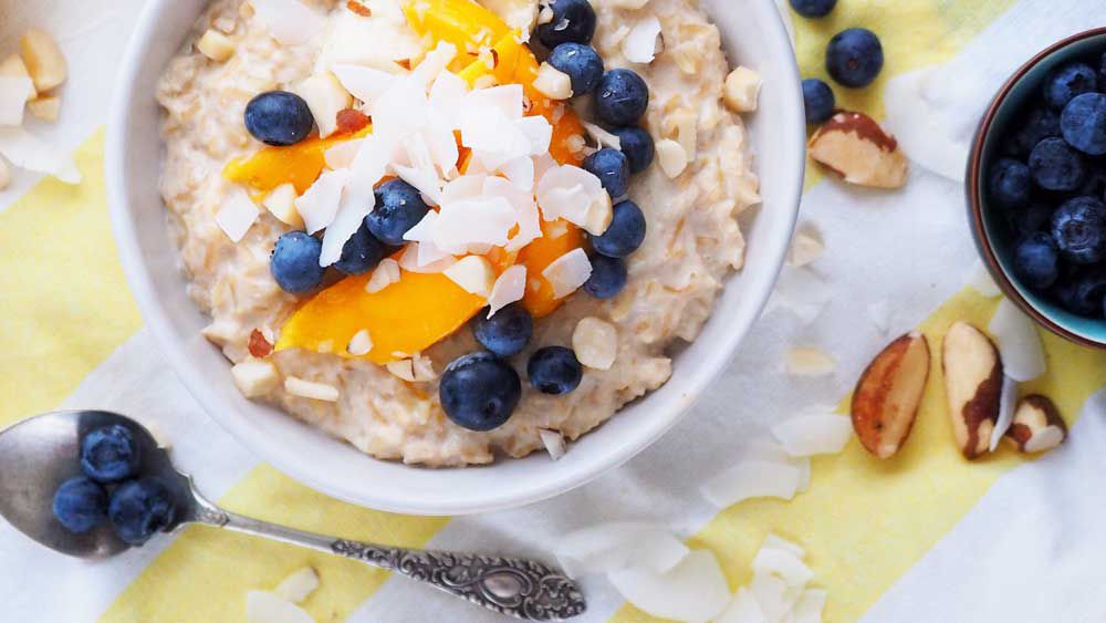 Coconut rice porridge with summer fruits
