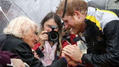 Prince Harry embraces a fan in Sydney, June 2017