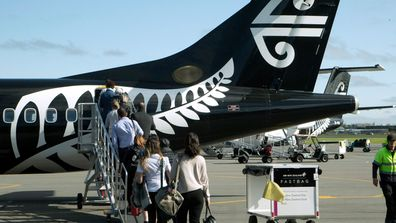 Passengers board an Air New Zealand flight at Christchurch Airport in Christchurch, New Zealand