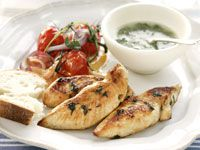 Chicken with green sauce and roasted tomatoes