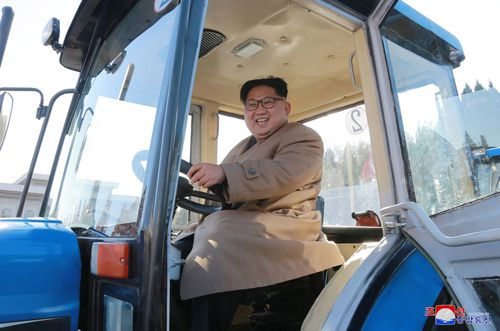 In this undated photo provided on Wednesday, Nov. 15, 2017, by the North Korean government, North Korean leader Kim Jong Un sits in a tractor at the Kumsong Tractor Factory, in Nampo, North Korea.