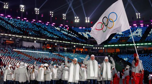 The Russian team. enter the opening ceremony under the Olympic flag. (AAP)