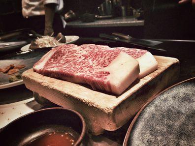 Two fresh cuts of authentic Kobe steak in a restaurant in Kobe, Japan.