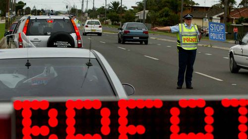 A roadside random breath test.