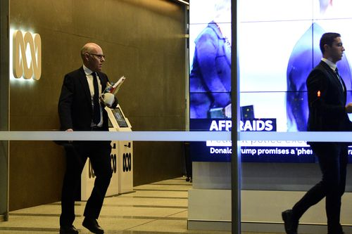 Australian Federal Police (AFP) investigators leave the main entrance to the ABC building located at Ultimo in Sydney, Wednesday, June 5, 2019.